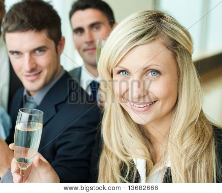 Businesspeople celebrating a success with champagne in office