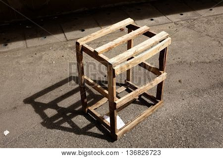 wood box frame  on side street with a beautiful shadow