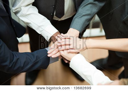 High view of people with hands together. Concept of union in business