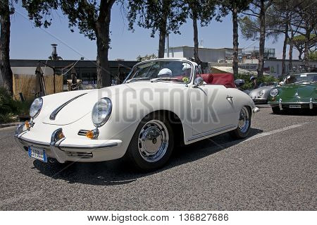 Naples Italy July 02 2016: Vintage Porsche during the annual historical re-enactment of the Grand Prix of Naples