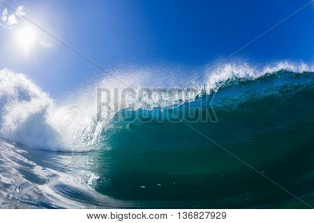 Wave inside hollow crashing blue ocean water swimming photo.
