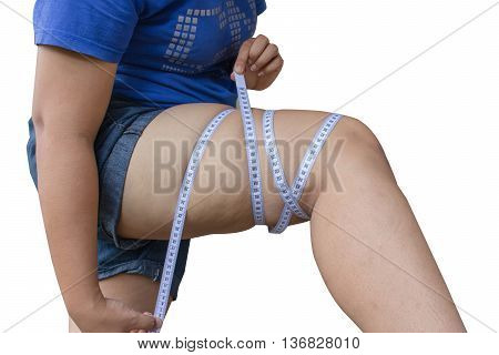 abdominal surface of fat woman on white background;Large girl legs with measuring tape isolated in white