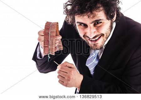 Businessman Lighting Firecrackers