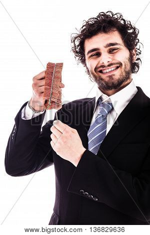 Smiling Businessman Lighting Red Firecrackers