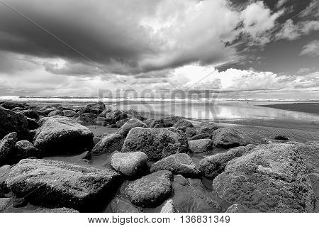 B&W of large boulders at the south end of Ocean Shores Washington.