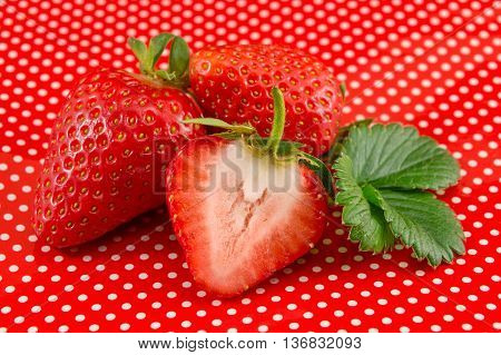 Fresh Strawberries On A Red Dotted Background