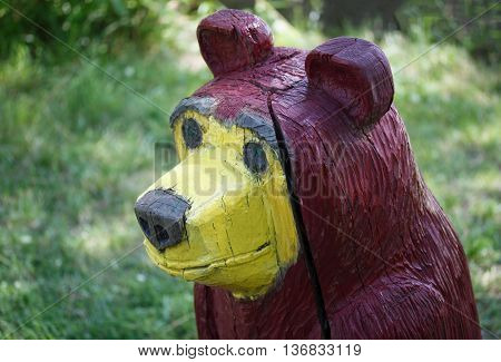 Small architectural form. Wooden sculpture of a bear