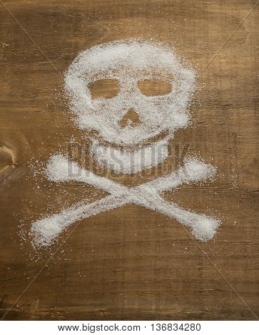 Skull on a light wooden background laid out from sugar