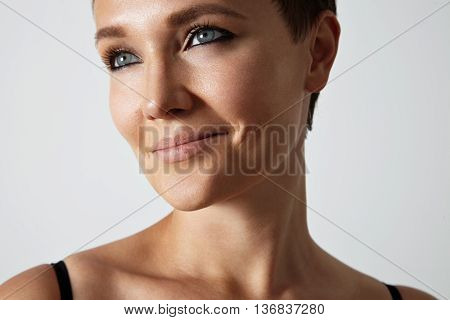 Beauty Young Woman With A Blue Eyes And Black Smokey Makeup