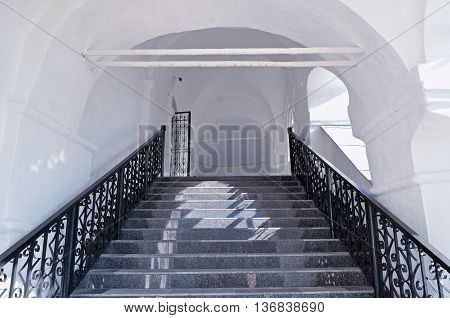 Staircase with antique wrought iron railing in Nicholas Vyazhischsky stauropegic monastery Veliky Novgorod Russia. Architecture view with decorative architecture iron details