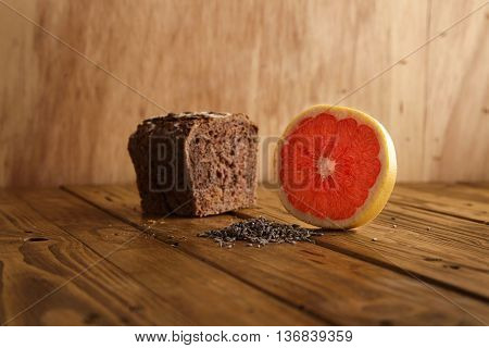 Exotic lavender grapefruit brown bread alternatively baked in artisan bakery presented on wooden table and rustic background