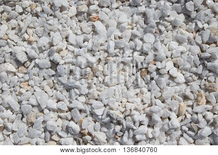 Texture gravel light gray color of various fractions as background