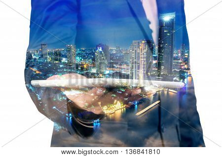 Double Exposure Of Night City And Business Man Using Digital Tablet Device As Business Development C