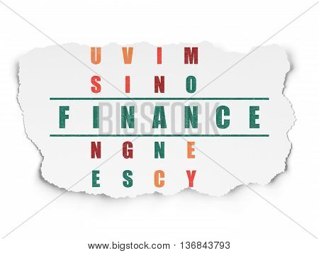 Banking concept: Painted green word Finance in solving Crossword Puzzle on Torn Paper background