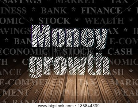 Banking concept: Glowing text Money Growth in grunge dark room with Wooden Floor, black background with  Tag Cloud