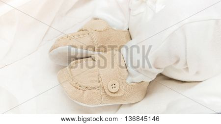 Baby Booties On The Feet Of The Baby