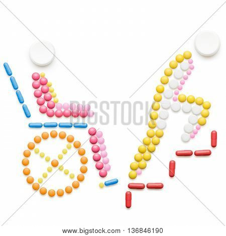 Healthcare concept made of drugs and pills isolated on white. Helpless person in a wheelchair in front of stairs.