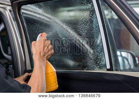 Car window tinting series : Spraying water on car window