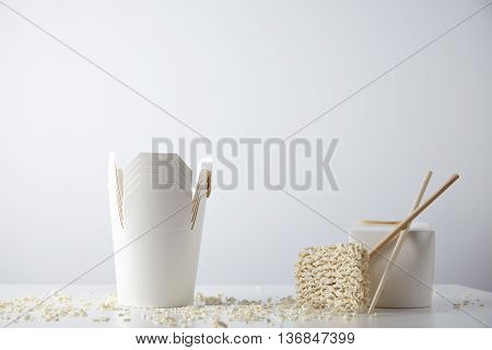 Many opened takeaway noodles boxes presented near closed with chopsticks and egg dry pasta, isolated on white Blank commercial retail promo mockup