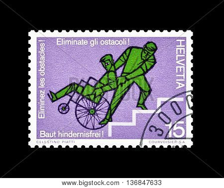 SWITZERLAND - CIRCA 1975 : Cancelled postage stamp printed by Switzerland, that shows Wheelchair transport on stairs.