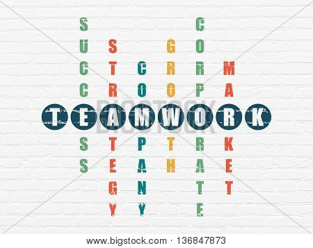 Finance concept: Painted blue word Teamwork in solving Crossword Puzzle