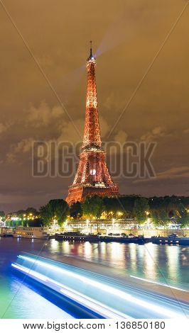 paris; France-July 03 2016 : The Eiffel tower lit up in red color for soccer Europe championship 2016 in France. The Eiffel tower is on of the most visited monuments in the wotrrld.