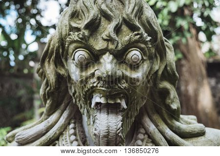 Traditional demon guard statue carved in stone in Indonesia.