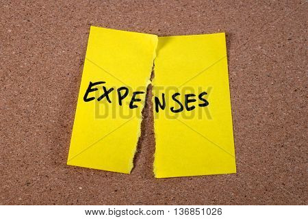 cutting expenses concept on a yellow memo- save your money