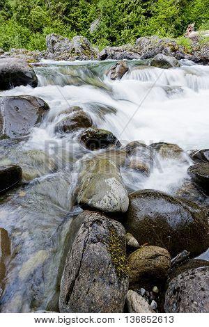 Rocks in a river in the Olympic Peninsula in Washington.