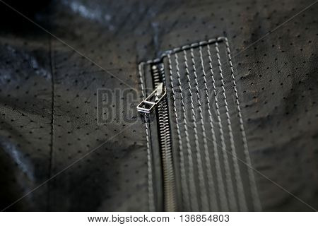 Dark leather texture and zipper background .