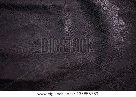Black Leather for Concept and Idea Style of Fine Leather Crafting Handcrafts Workspace Handmade or Handcrafted Leather Worker. Background Textured and Wallpaper. Vintage Rustic. Close up Full frame.