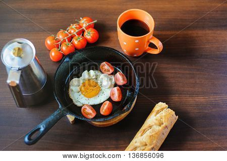 Eggs Mozzarella With Basil And Tomatoes On A Frying Pan