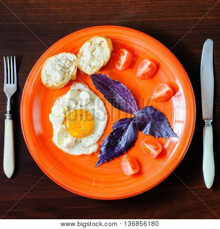 Eggs Mozzarella With Basil And Tomatoes On Orange Plate