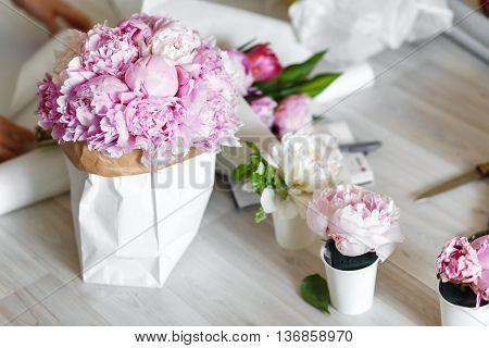 Pink peonies in kraft paper bag - workshop
