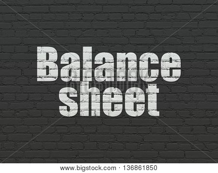 Currency concept: Painted white text Balance Sheet on Black Brick wall background