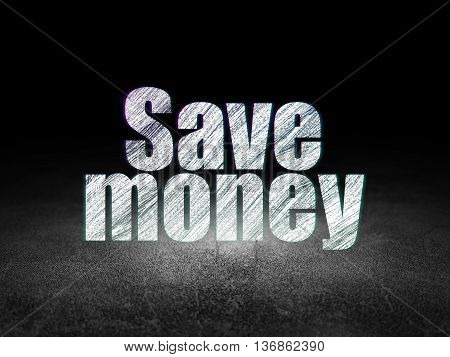 Currency concept: Glowing text Save Money in grunge dark room with Dirty Floor, black background