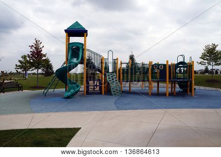 SHOREWOOD, ILLINOIS / UNITED STATES - AUGUST 30, 2015: Children 5-12 years old may climb and slide on the playground equipment in the Village of Shorewood's Towne Center Park.