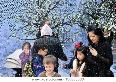 Sydney Australia - July 3 2016. Families enjoy the snow on the Winter Festival. The Winter Festival's in Sydney are Australia's largest winter events captivating entertainment for the whole family.