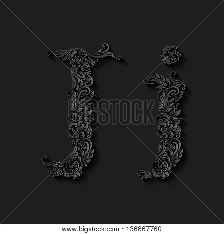 Handsomely decorated letter j in upper and lower case on black
