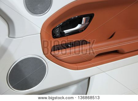 Luxury car door trim close up shot
