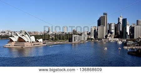 Sydney Australia - July 3 2016: Sydney Opera House and Circular Quay view from Harbour Bridge. The Sydney Opera House is identified as one of the 20th century's most distinctive buildings.