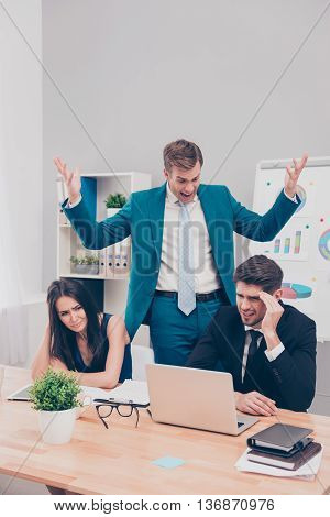 Furious Businessman Screaming At His Colleagues For Failed Business Project