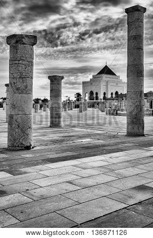 columns around the mausoleum of mohammed,black and white