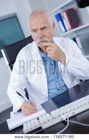 pensive senior doctor