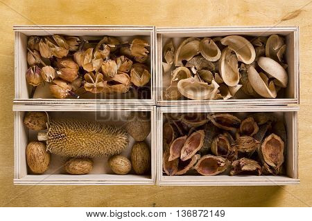 Dry potpourri in boxes on a wooden background