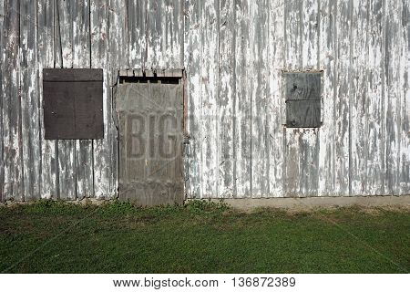 The boarded up windows and door of an abandoned 19th century barn in the Plainfield Park District's Eaton Preserve in Plainfield, Illinois.