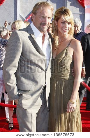 Kevin Costner and Christine Baumgartner at the World premiere of 'Swing Vote' held at the El Capitan Theater in Hollywood, USA on July 24, 2008.
