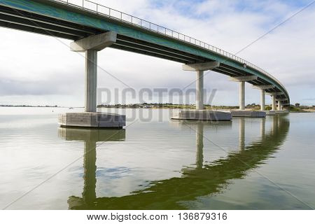 Bridge between Goolwa and Hindmarsh Island South Australia with reflection in the water. Part of the Fleurieu Peninsula.