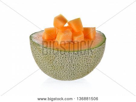 half cut and portion cut ripe cantaloupe on white background
