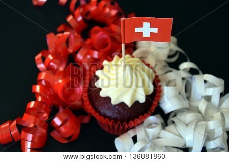 Swiss National Day cupcake with red and white cross swiss flag.